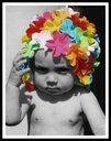 kid with flower hat